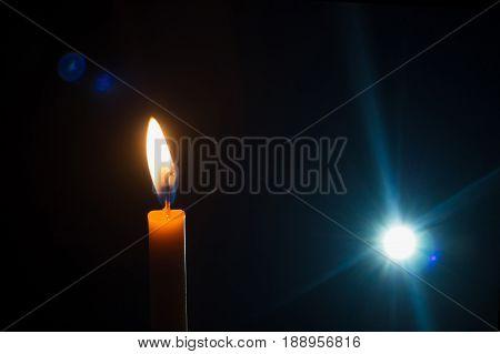 Candle light black background light fairway flashlight on a black background.