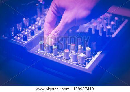 Close up of hand using studio sound equipment
