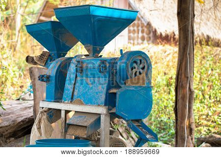 small rice mill machine after work in the farm very useful rice mill machine for home use or small business.
