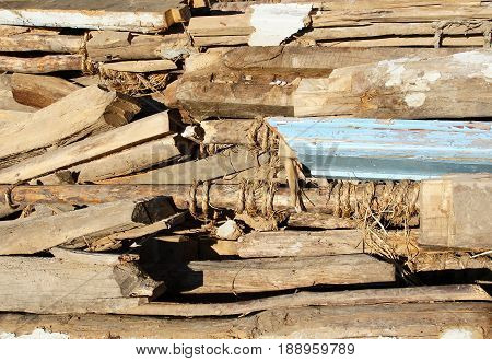 Old logs and boards obtained after the destruction of the old wooden house