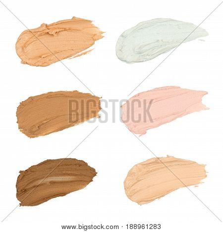 Close up Color correcting concealer on white