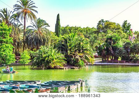 Boating in the park Parc de la Ciutadella, Barcelona, Catalonia, Spain. Small lake is a popular tourist spot in historic center of city.