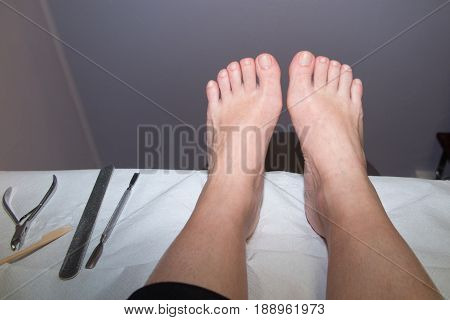Client Feet Waiting For A Professional Manicure