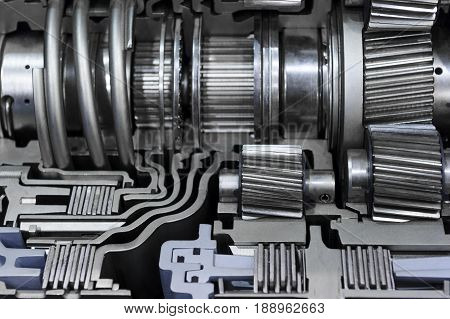 Gear box cross section, engine industry, sprockets, cogwheels and bearings of automotive transmission for oversize trucks and construction vehicles, selective focus