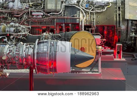 Fighter jet and helicopter engines in row, internal structure with hydraulic, fuel pipes and other hardware and equipment, army aviation, military aircraft and aerospace industry