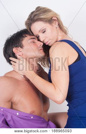 The photo is of a hot steamy couple in an embrace.