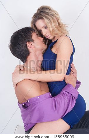 The photo is of a man and a woman hugging one another.