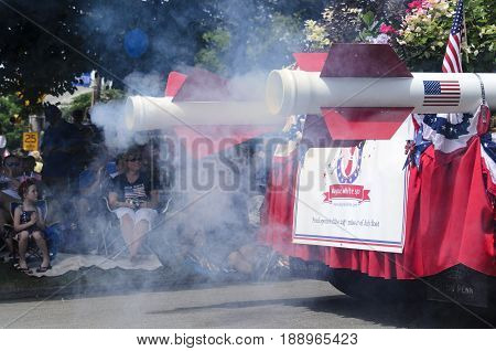 BRISTOL RHODE ISLAND - JULY 4 2011: Smoke from rocket-powered float at Fourth of July parade in Bristol Rhode Island