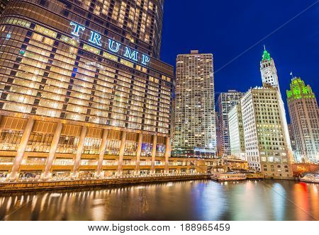 Chicago - March 2017, IL, USA: Downtown Chicago at night. View of Illuminated buildings in the central part of the city. Trump Tower and The Wrigley Building reflected in Chicago river
