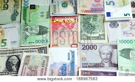US dollars, Korean Won, Euro bills and some money bills and banknotes background. Currency foreign exchange. Business and Financial or money management for investments.