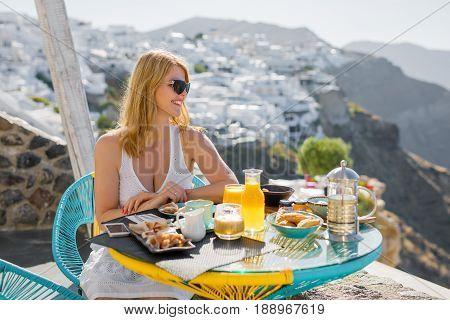 Woman having breakfast in luxury Mediterranean resort