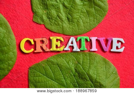 word creative on a  abstract red background