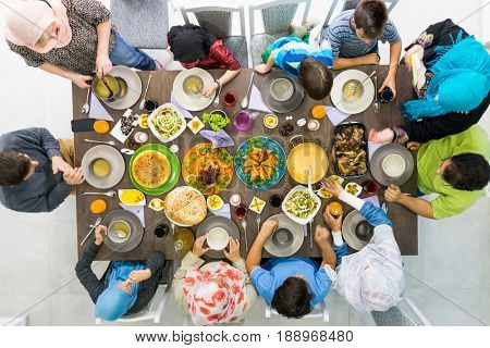 Family together eating food top view