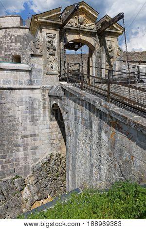 Drawbridge In Fort De Joux. The Castle Commands The Mountain Pass Cluse De Pontarlier And Was Improv