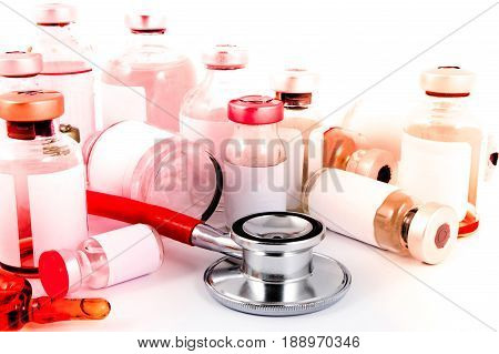 Medical ampules pills, syringe and doctor stethoscope in laboratory. Doctor health care and equipment concept on white background.