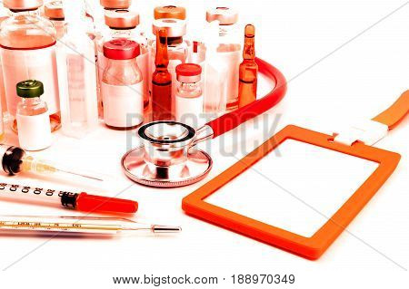 Hospital equipment stethoscope medical ampules pills, name tag and syringe on white background. Doctor and health care and equipment concept.