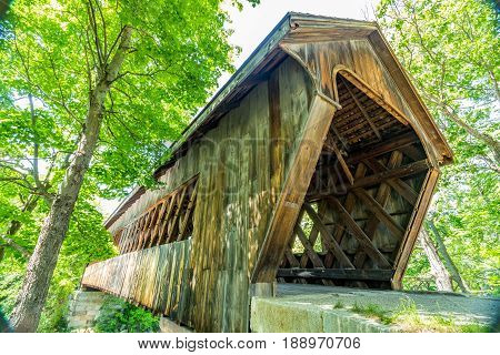 The Henniker Covered Bridge is a covered pedestrian footbridge serving New England College across the Contoocook River in Henniker New Hampshire.