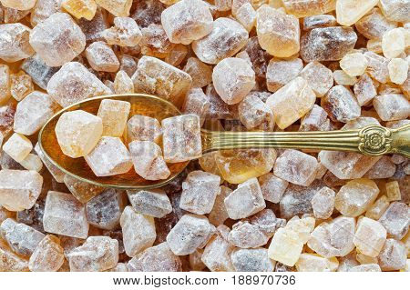 Caramelized Brown Sugar In Spoon. Cane Sugar Cubes Background.