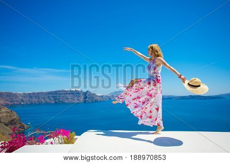 Free and  happy woman enjoying life in summer