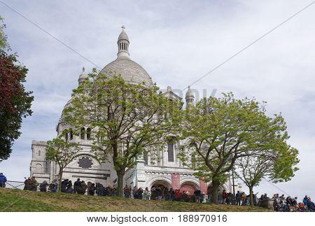 ParisFrance- April 30 2017: Tourists walk rest and take pictures near the Basilica Sakre-Coeur