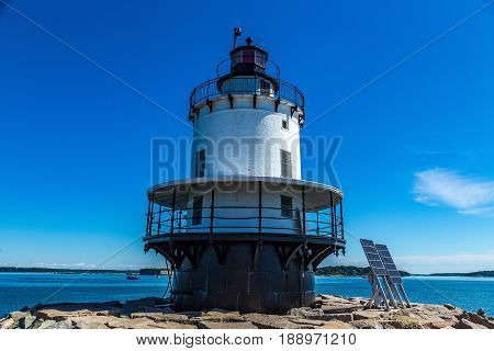 Spring Point Ledge Light is a sparkplug lighthouse in South Portland Maine that marks a dangerous obstruction on the west side of the main shipping channel into Portland Harbor. It is now adjacent to the campus of Southern Maine Community College.