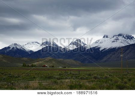 The Lost River Mountains provide a beautiful background for ranches near Mackay, Idaho.