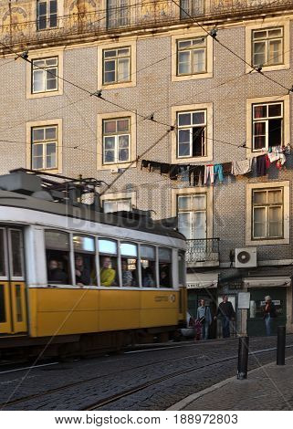 LISBON-DECEMBER 3 2016: Trolley car crosses a street in Lisbon in the afternoon, Portugal on December 3, 2016
