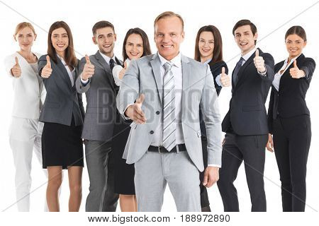 Happy business team with thumbs up isolated on white background