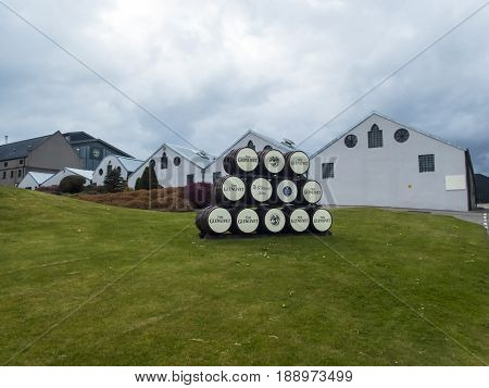 GLENLIVET SCOTLAND - 13 MAY 2017 - Whisky barrels used as signs outside the famous Glenlivet Distillery where traditional single malt whiskies are made.