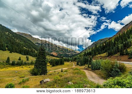 The San Juan Skyway forms a 233 mile loop in southwest Colorado traversing the heart of the San Juan Mountains festuring breathtaking mountain views and includes the portion of US 550 between Silverton and Ouray known as the Million Dollar Highway.