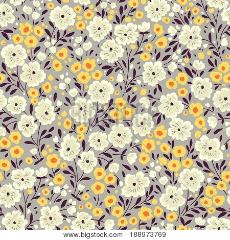 Vector seamless pattern. Cute pattern in small flower. Small yellow and white flowers. Gray background. Ditsy floral background. The elegant the template for fashion prints.