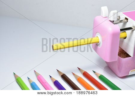Image Pencil Sharpener and color pencil on white background