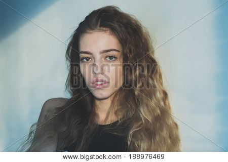 Girl With Young Face And Natural Blond, Long Hair