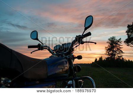 Handlebar Motorcycle Close-up On Sunset Background,