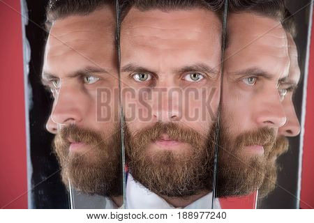 Face Of Serious Bearded Hipster Man, Businessman Reflecting In Mirror