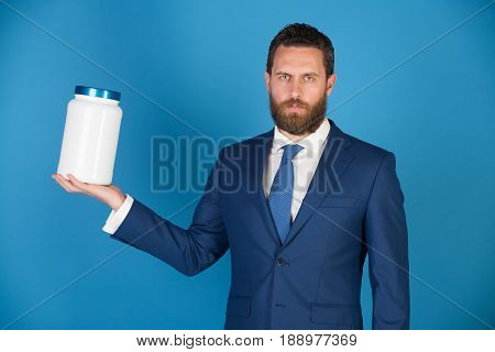 Businessman Or Bearded Man With Plastic Jar On Blue Background