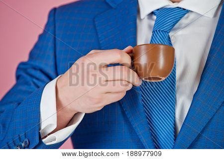 coffee cup in hand of man or businessman in blue formal outfit morning and refreshment coffee break energy and idea