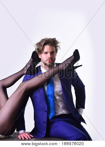 couple in love. legs of woman and man or businessman in suit fashionable shoes and tights isolated on white background love and relations power boss office romance sexual services couple in love