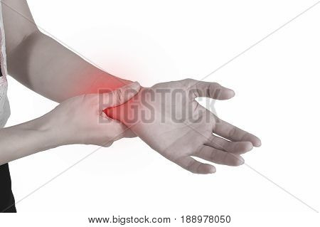 Holding hand to spot of wrist pain.