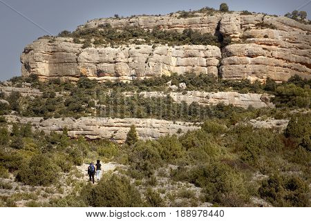 BECEITE-FEBRUARY 21 2016: Two people make mountaineering in the Penya Galera way near Beceite village in Los Ports Mountains, Spain on February 21, 2016