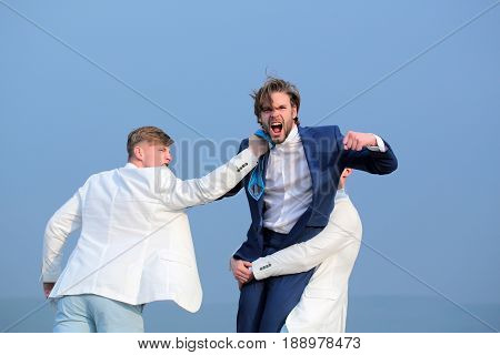 Group Of Business People Fighting On Blue Sky Background, Conflict