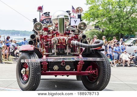 BRISTOL RHODE ISLAND - JULY 4 2011: Antique fire truck takes part in the Fourth of July Parade in Bristol Rhode Island