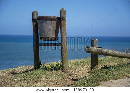 Photo of a wood litter bin with selective focus and sunlight