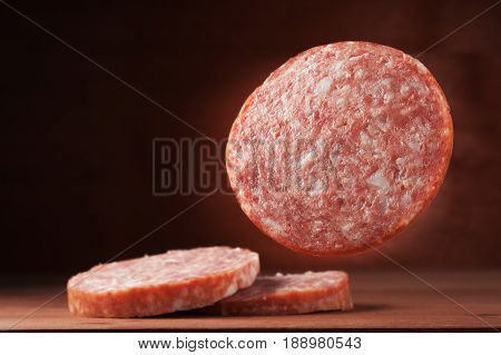Sausages salami on a wooden background delicatessen, delicious,