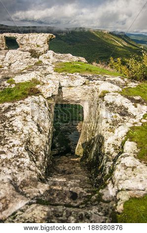 Medieval cave city-fortress Chufut-Kale in the mountains Bakhchisaray Crimea.