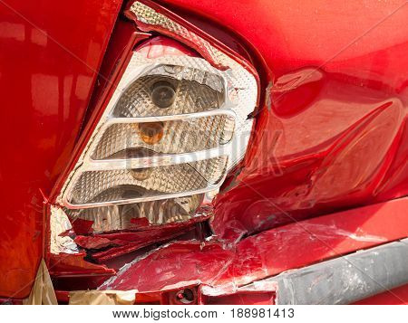 Damaged tail and side of a car because of an accident
