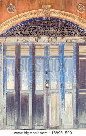 Rustic Wooden Folding Doors In Front Of Classic Sino-portuguese Architectural Style Shophouse Buildi