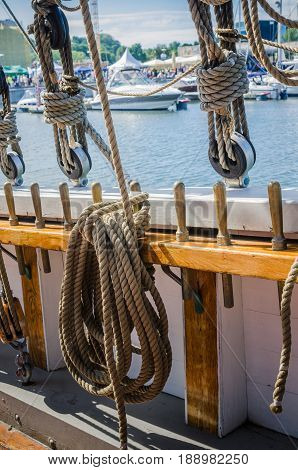 Rigging on the old sailboat against the background of modern yachts