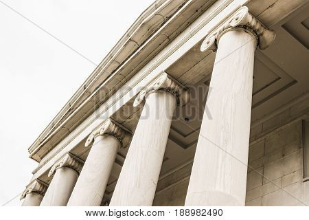Upward View of Grecian-Style Pillars Along the Front of a Building