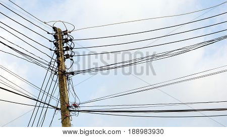 Electricity and utility pole and power lines in the blue sky